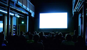 Watching movie-theater-thumb-550x321-45552